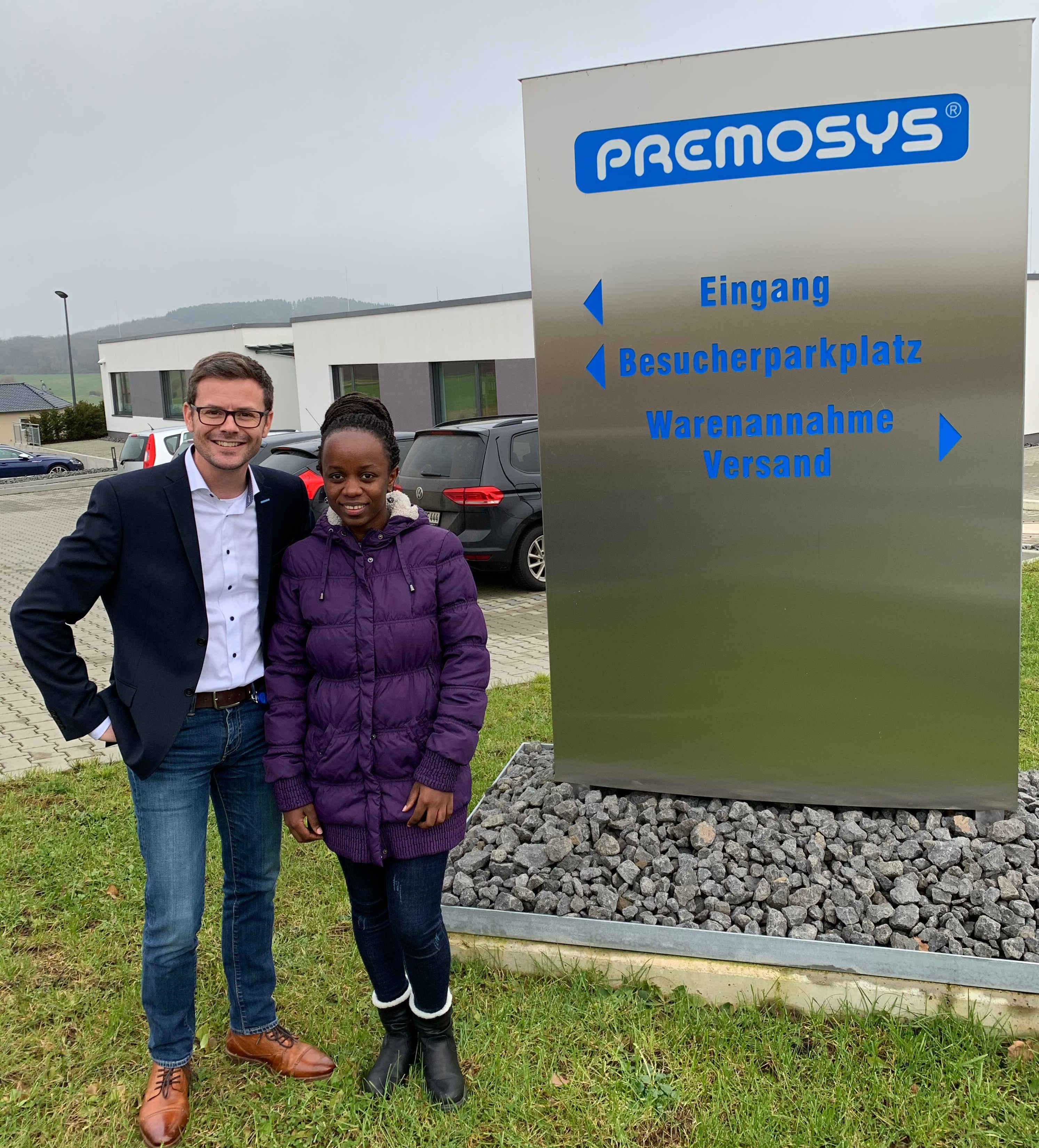 Frau Emelyne Izere mit Herrn Marcel Hommes von der Premosys GmbH